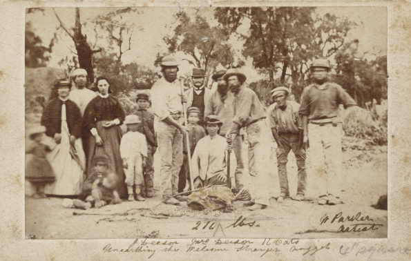 Miners and their wives pose with the nugget. 1869