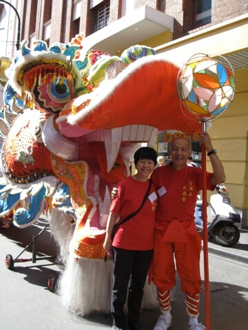This is a photo of Len Quon, founder of the Millennium Dragon and me while we wait to join in the Moomba procession which is held for Labour Day. Len is holding the pearl of wisdom which he waves in front of the dragon to entice him to follow.